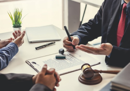 Lawyer and Client Discussing Property Disputes in Galesburg IL