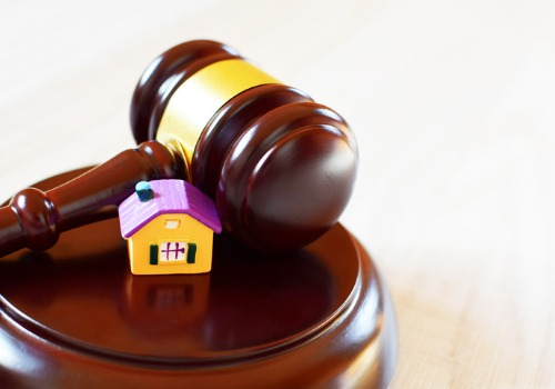 Toy House and Gavel on the Desk of a Lawyer Who Handles Property Disputes in Galesburg IL