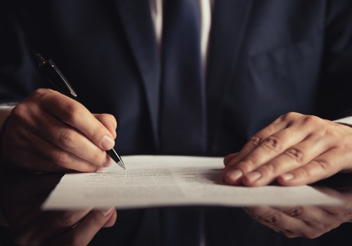 Lawyer Reviewing Wills & Trusts in Galesburg IL