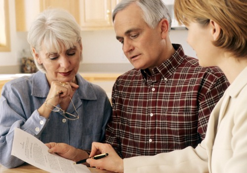 An elderly couple meeting with an attorney to discuss Estate Planning in Monmouth IL